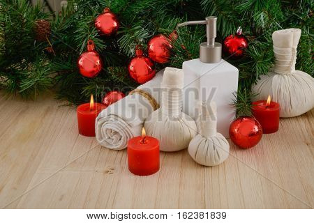 Spa treatment with Christmas decorations - wooden background