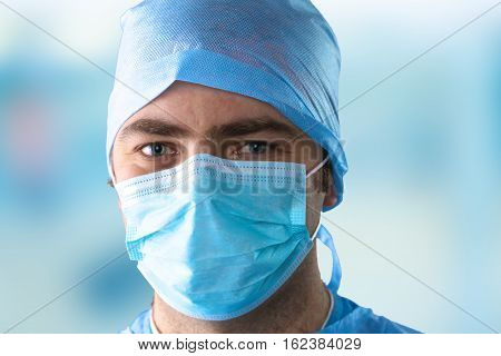 Man surgeon holds a scalpel in an operating room .