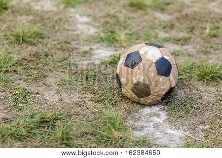 Old  ball football on grass , tream sport