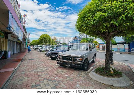 Labuan,Malaysia-May 3,2016:Carpark in the street of Labuan,Malaysia.Labuan island having problem with parking space due to limited space & many new cars in the Labuan island road due to duty-free cars