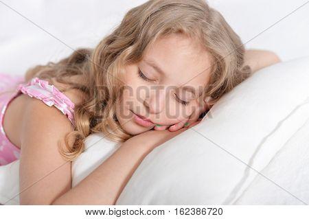 Portrait of a cute little girl fall asleep