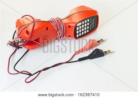 Isolated telephone line tester on white with clipping path