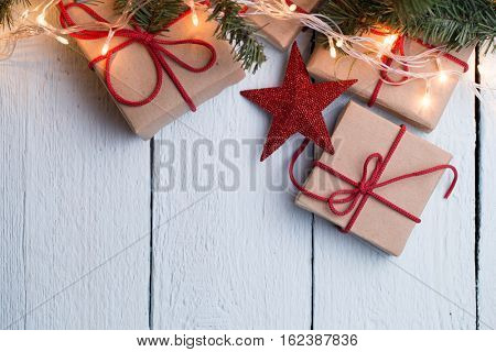 Presents, red stars, pine branch