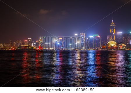 Hong Kong, China - January 1, 2016: Hong Kong island skyline seen from the waterfront of Tsim Sha Tsui in Kowloon with Central Plaza and Hong Kong Convention and Exhibition Centre.