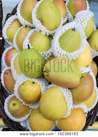 a lot of pear in the basket