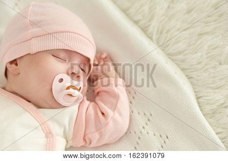 little cute newborn baby girl close up