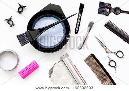 Tools for hair dye and hairdye top view on white background