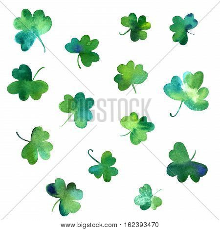 A collection of hand drawn watercolour shamrocks, isolated on white background, to be used as design elements