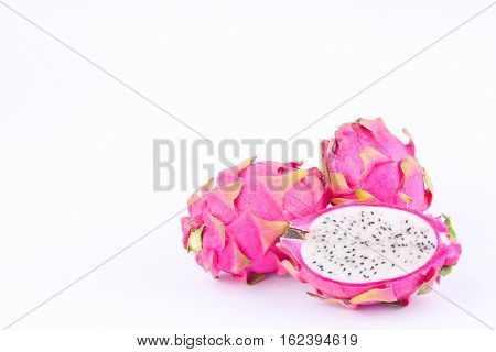 dessert vivid and vibrant dragon fruit (dragonfruit) or pitaya on white background healthy dragon fruit food isolated