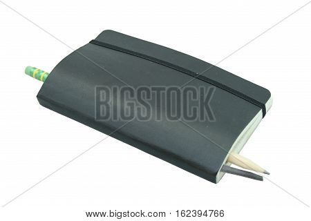 A black leather notebook with a pencil isolated on white