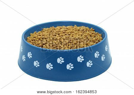 A blue bowl of dogfood isolated on a white background