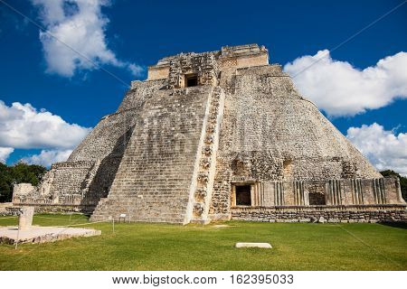 Pyramid of the Magician (Piramide del adivino) in ancient Mayan city Uxmal, Mexico