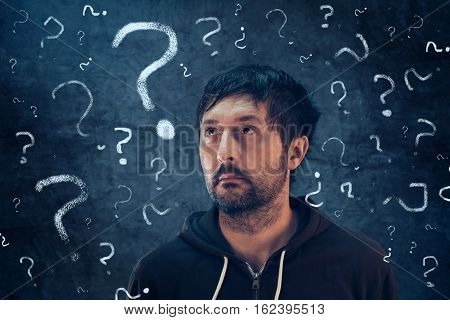 Confused man with so many questions looking for the answer to his problems