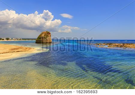 SUMMER Salento coast: Torre Pali beach (Lecce). ITALY (Apulia).The low sandy coastline is charactherized by dunes covered with Mediterranean scrub.Its name comes from the sixteenth-century watchtower.
