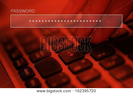 Typing online account password on laptop computer keyboard internet security concept