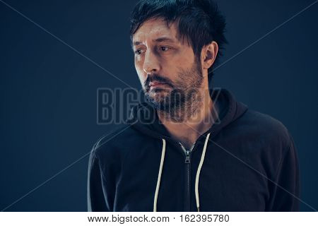Confused man with so many questions looking to side for the answer to his problems