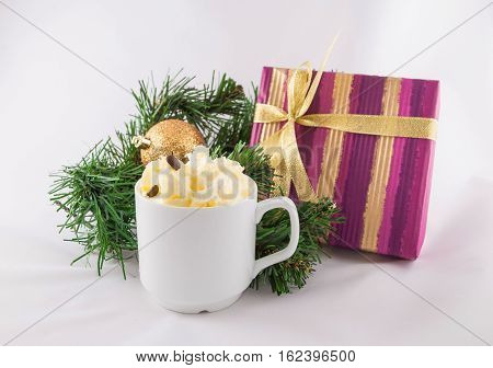 New Year's still-life with a cup of coffee with cream and gift box