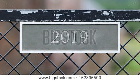 Sign On Fence - 2019