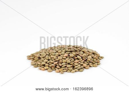 Organic lentils Isolated on a white background. Close up shot.