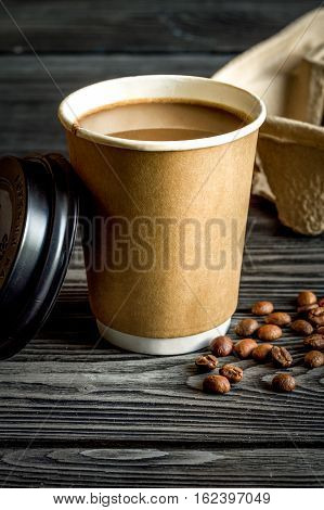 coffee cup take away at dark wooden background