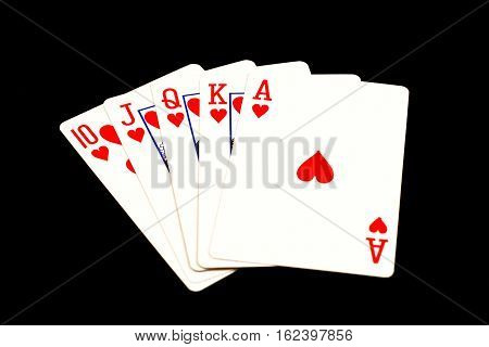 A royal flush poker hand on black