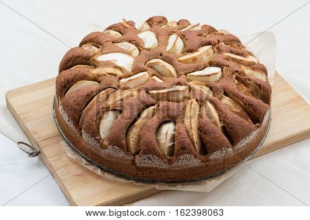 Vegetarian apple cake on a wooden board