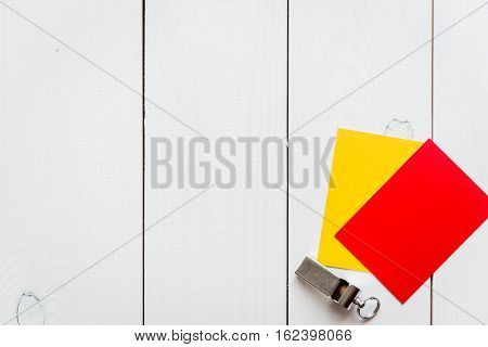 red and yellow cards on wooden background top view mock up