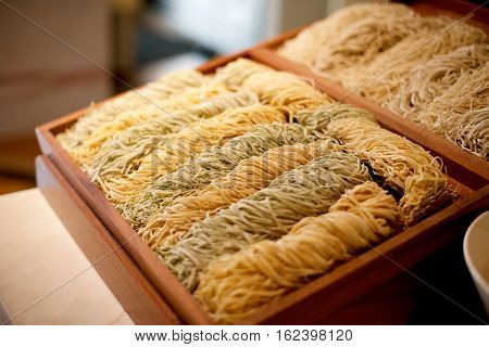 Fresh raw Chinese noodles on a tray