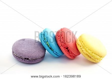 Colorful macarons on white background. Macaron is sweet meringue-based confection
