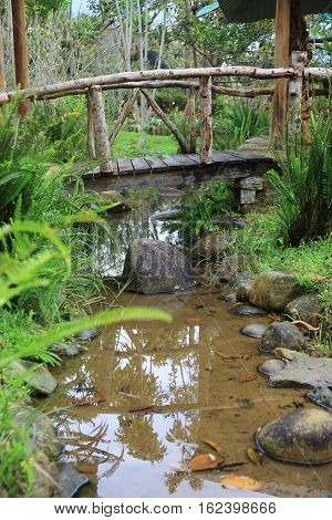 Element of landscape design the wooden bridge across the brook