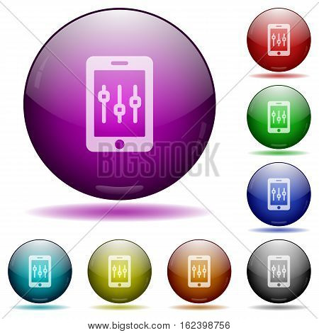 Smartphone tweaking color glass sphere buttons with shadows.