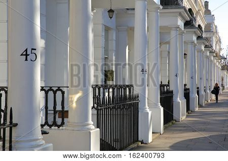 LONDON, UK - NOVEMBER 28, 2016: Row of white luxury houses facades in South Kensington