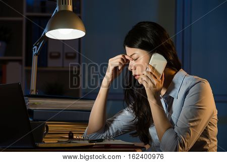Asian Business Woman Headache On Smartphone Working Overtime