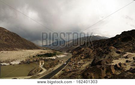 Panorama of Indus river and valley with bridge Karakoram Pakistan