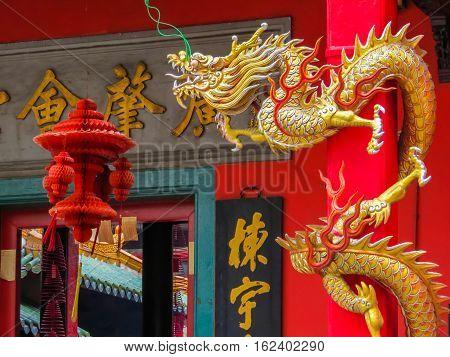 KUALA LUMPUR, MALAYSIA - JANUARY 11, 2014: Golden dragon at an entrance to the GuanDi Temple. Chinatown, Kuala Lumpur, Malaysia