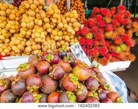 Exotic fruits, mangosteen and rambutan, on the street market. Chinatown, Kuala Lumpur, Malaysia. Selective focus
