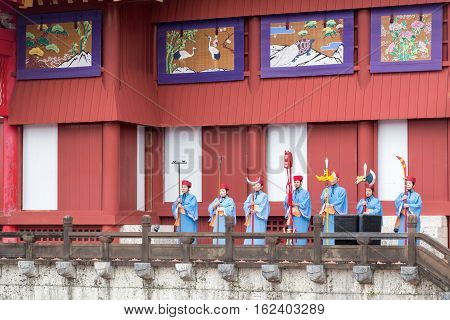 Okinawa, Japan - January 02, 2015: Dressed-up people performing a show at the traditional New Year celebration at Shuri-jo castle