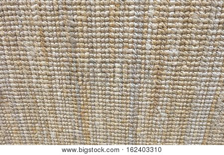 Background Pattern Horizontal Texture of Brown Weaving Fabric Doormat with Copy Space for Text Decoration.