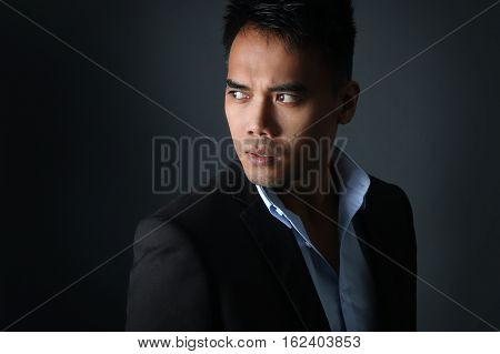 Handsome Filipino posing over a gray background