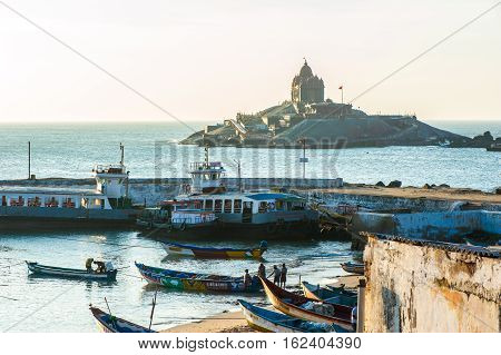 View on Vivekananda Rock Memorial and fishing boats from coast in Kanyakumari town, 7 October 2016, Tamil Nadu state India