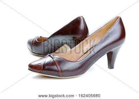 Brown female shoes isolated on a white background
