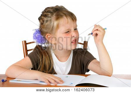 girl with pout looks at the pen