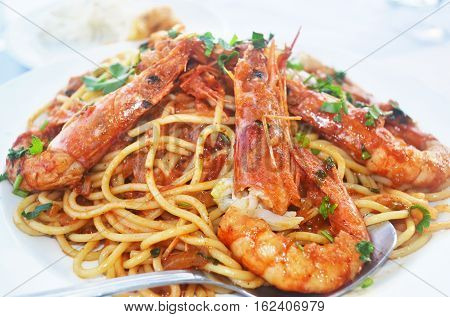mediterranean seafood - pasta with shrimps at a greek tavern