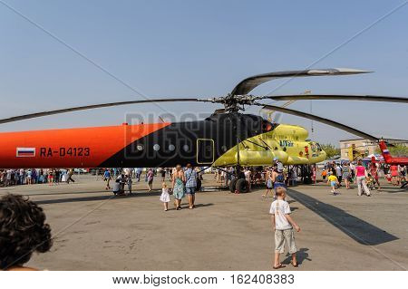 Tyumen, Russia - August 11, 2012: Air show On a visit at UTair in heliport Plehanovo. People explore the MI-10K helicopter