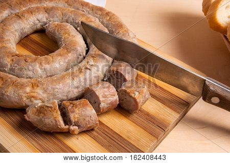 Sliced Roasted Traditional Homemade Sausage With Spices And Herbs And Wheat Bread.