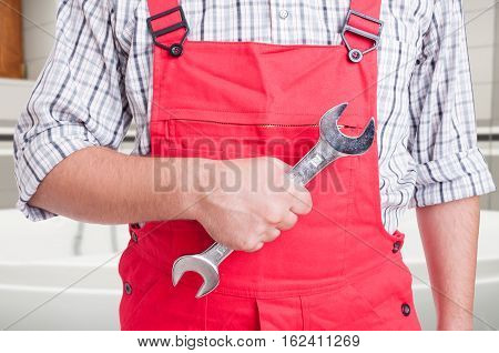Male Fitter Holding Steel Wrench In Close-up