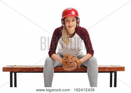 Female baseball player with a catcher glove and a helmet sitting on a bench isolated on white background
