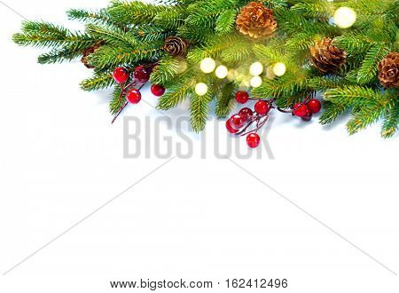 Christmas Tree with Cones border isolated on a White background. New Year holiday evergreen tree, Xmas green art corner design. Branches of fir tree decorated with holly berry, cone, light garland