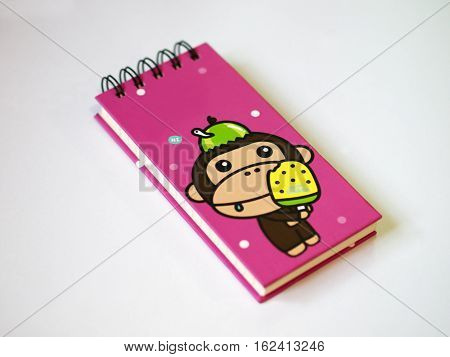COLOR PHOTO OF PINK NOTEBOOK WITH WHITE BACKGROUND