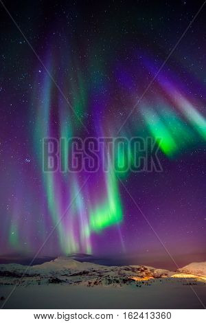 Aurora northern lights on the sky over the mountains in Norway smartphone background
